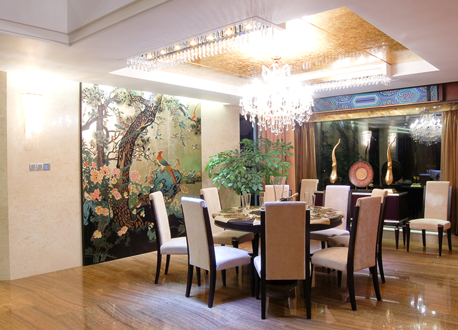 Elegant dining room with crystal chandelier featuring chinoiserie style decor.