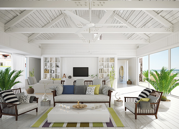 Beach house with modern layout and white shiplap walls with large sliding doors letting light in on either side