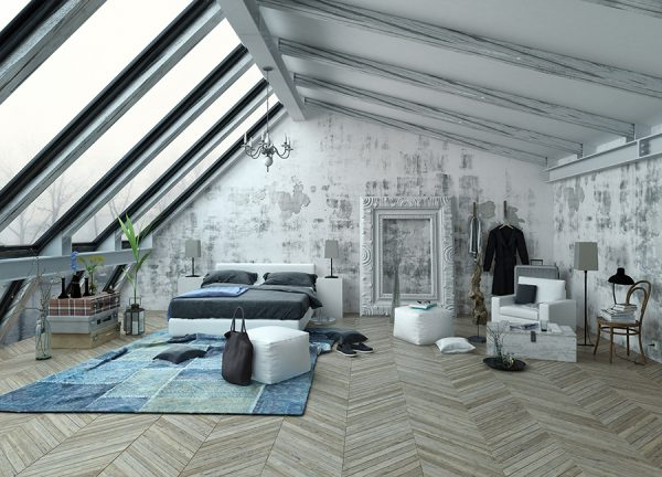 Loft-style bedroom with industrial-type decor and large roof windows.
