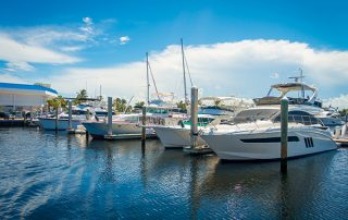Boats being displayed in the water on a sunny day at the Fort Lauderdale International Boat Show in Florida