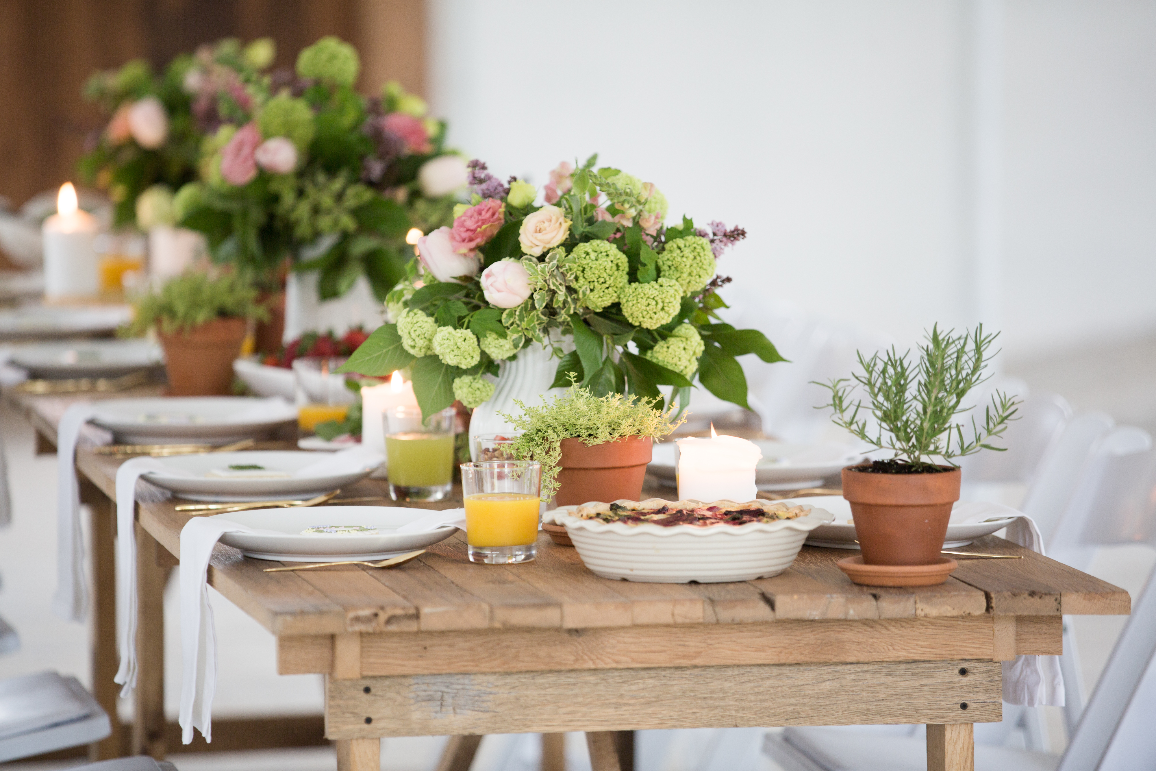 floral arrangements and place settings on picnic table
