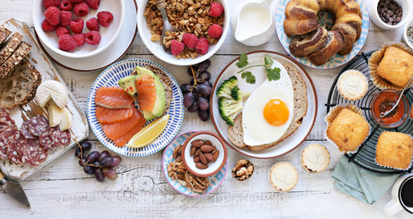 variety of brunch food on picnic table