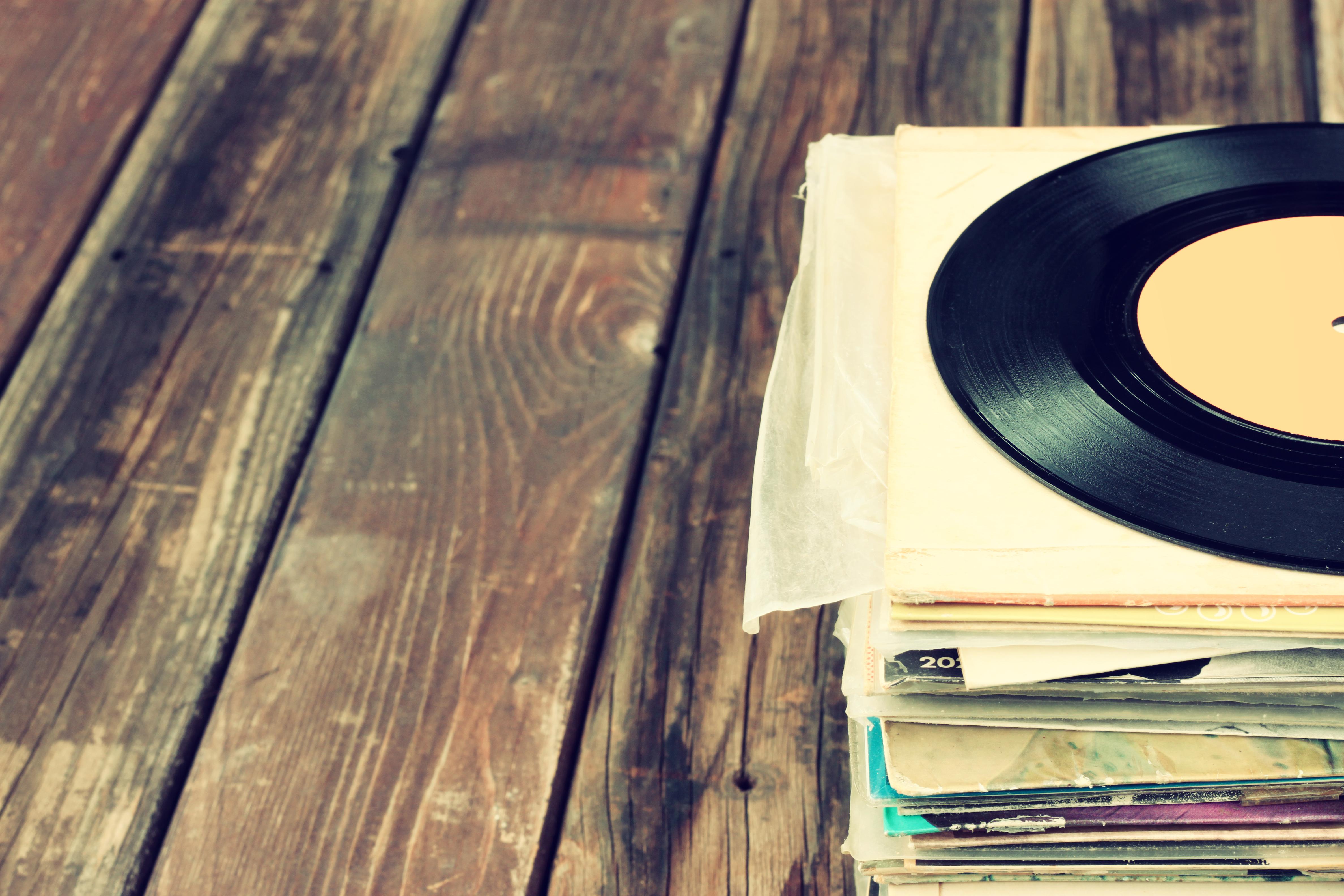 vinyl records stacked on floor