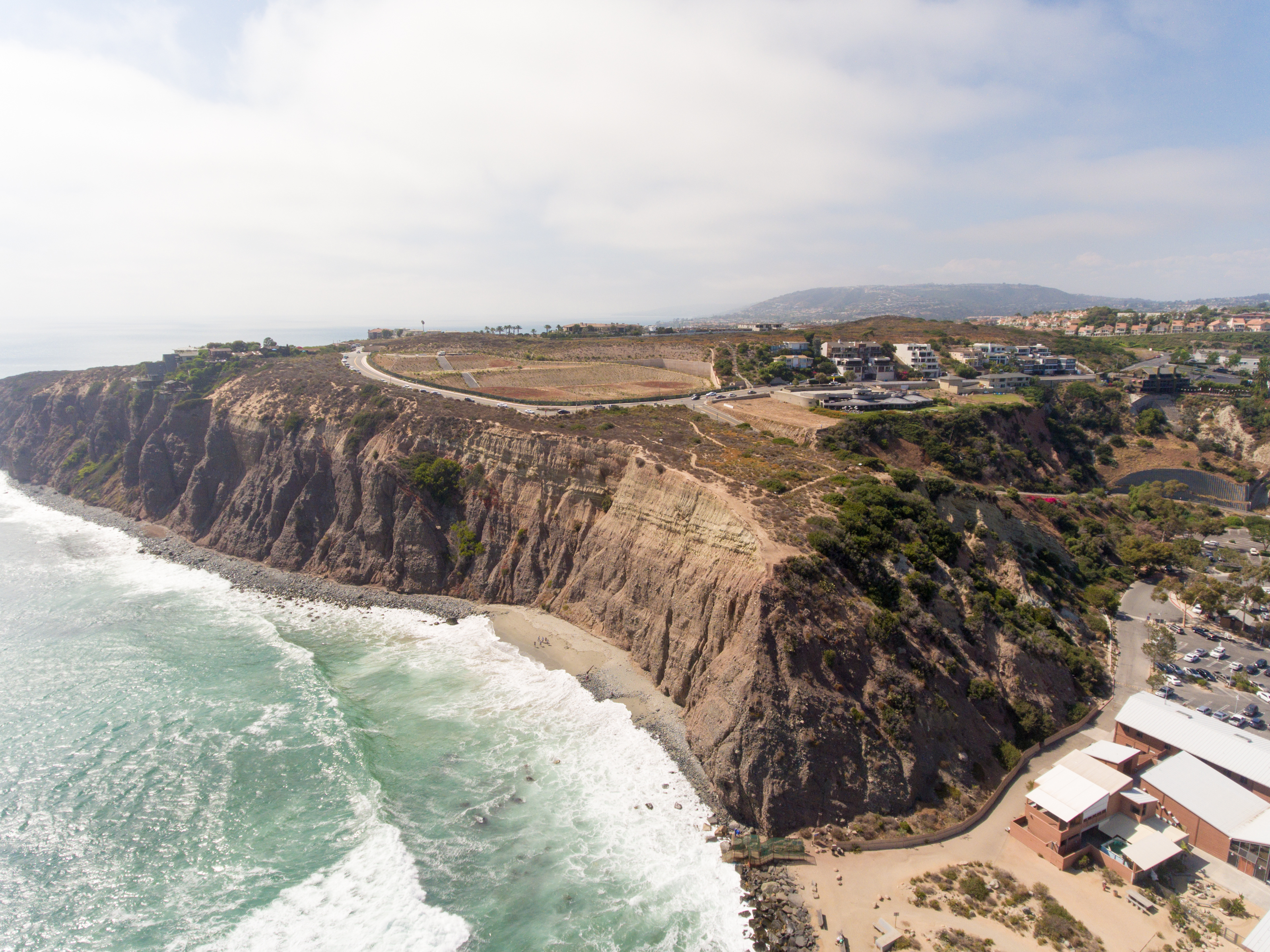 arial view of the cliffs and beach of Dana Point, CA