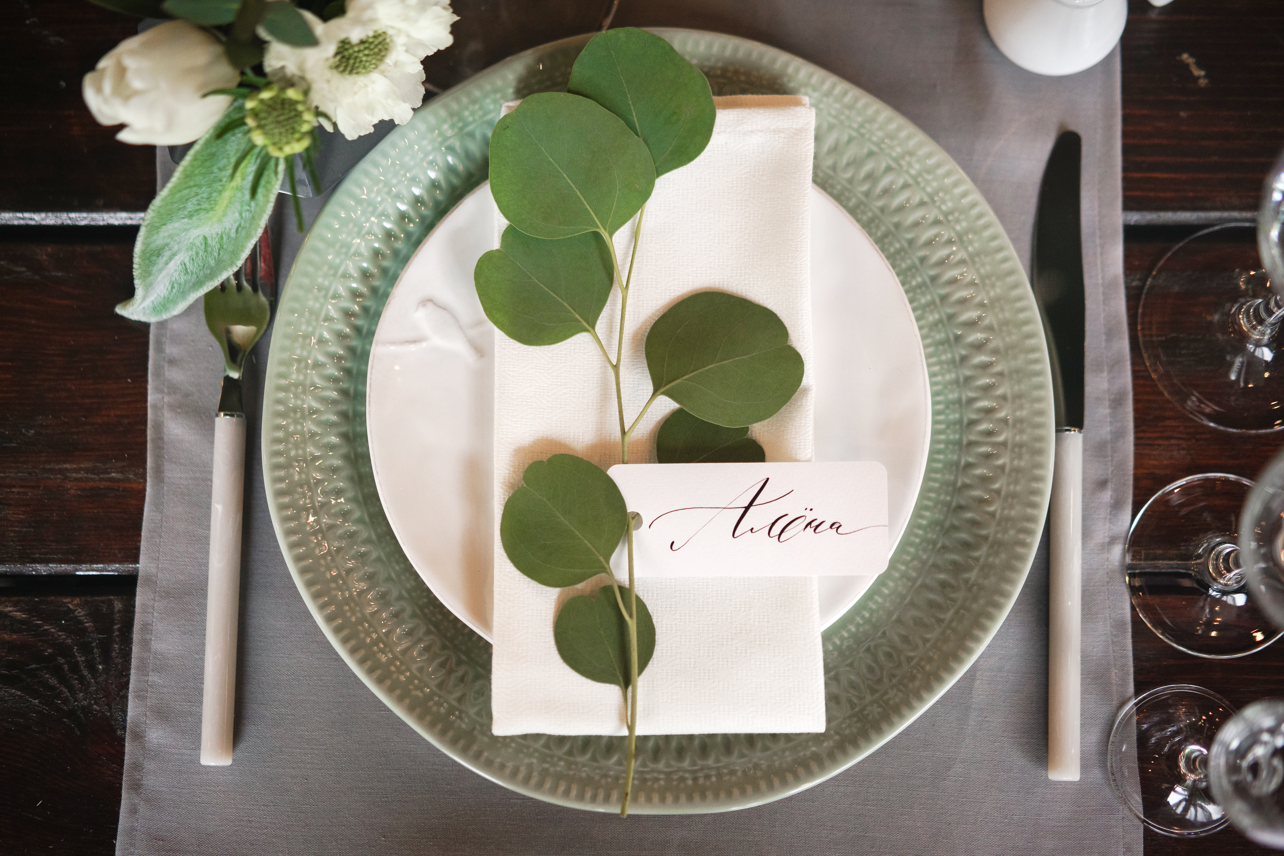 place setting with leafy accent and flowers