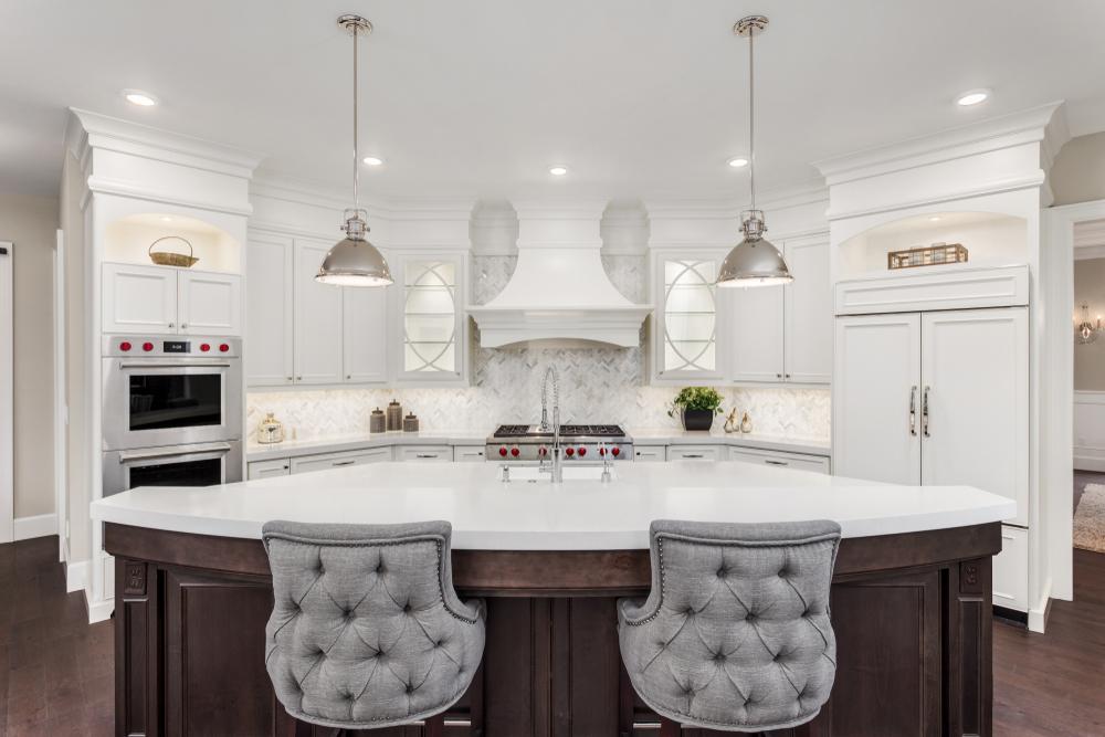 dark colored island in white kitchen