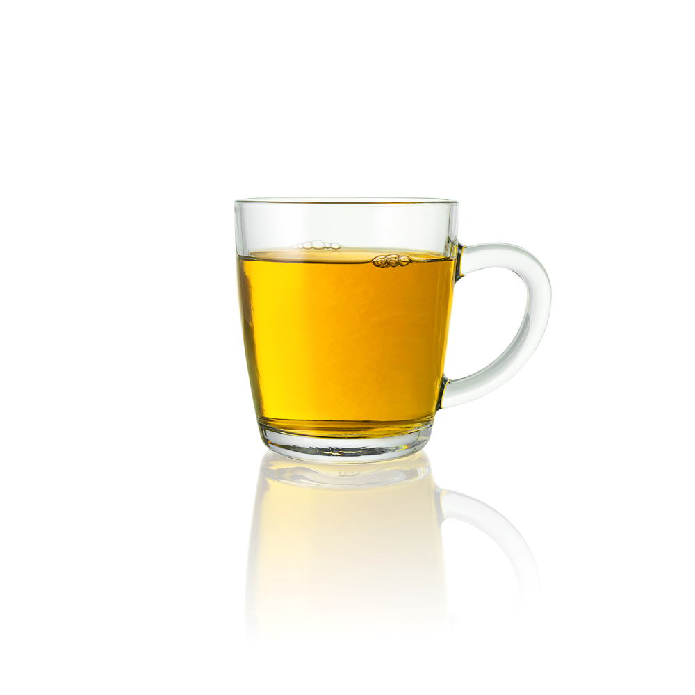warm tequila drink in a glass mug