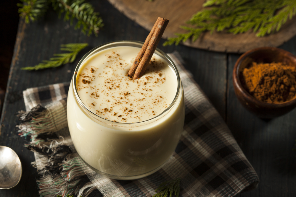 eggnog with a cinnamon stick