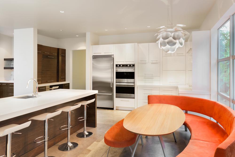 orange banquet seating in white kitchen