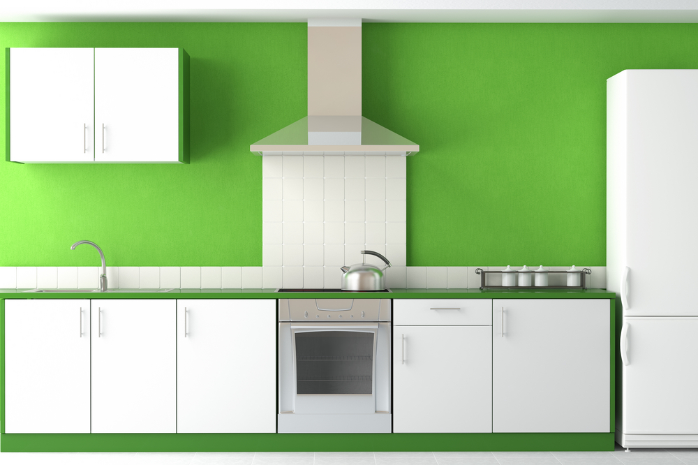 Bright green wall in white kitchen