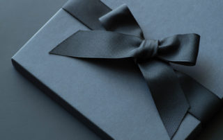 black gift box with black ribbon