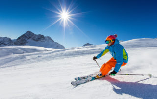 downhill skier in sunshine