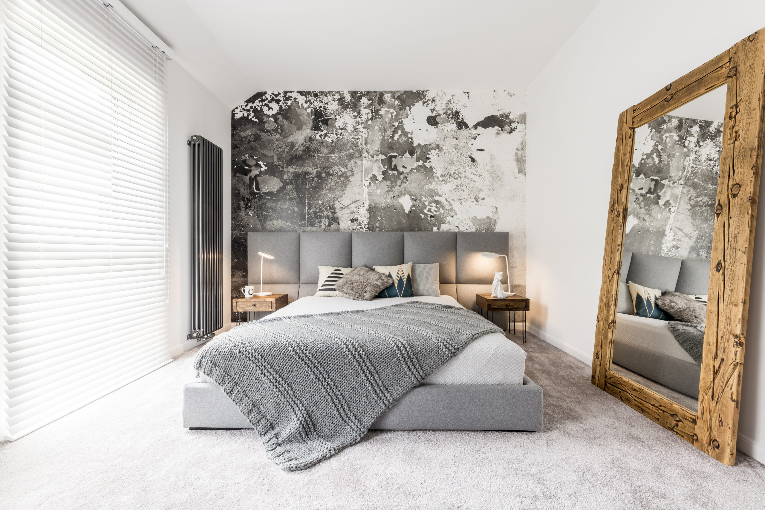 bedroom with huge leaning mirror