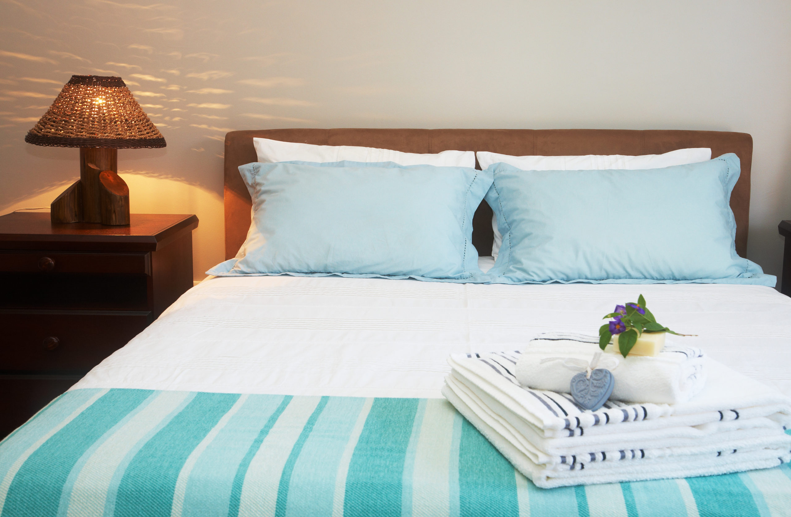 guestroom with little touches like towels, snack