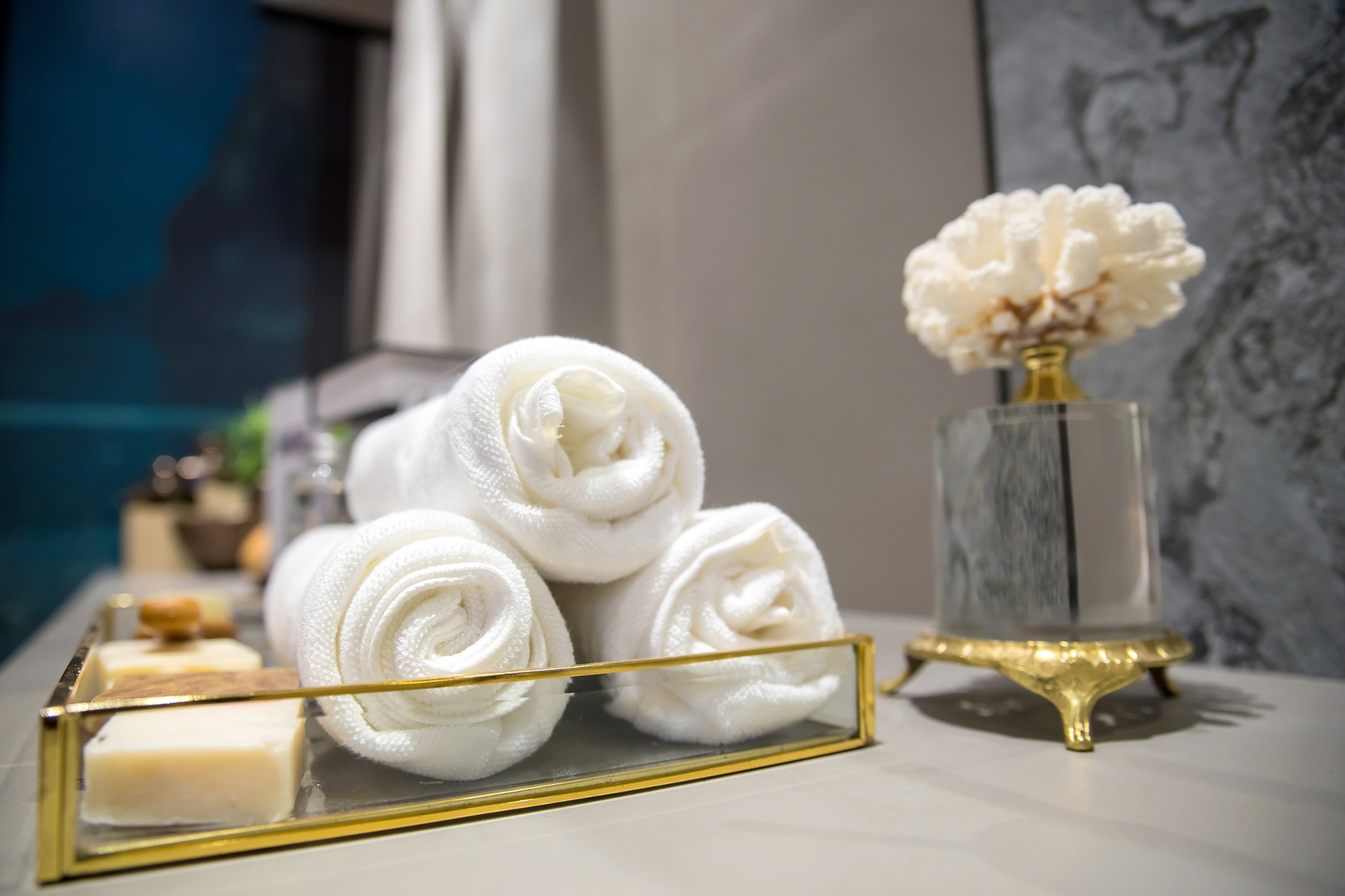 towels, soaps and flower arraigned in elegant tray