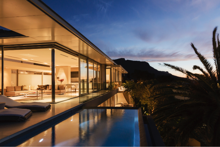 Evening photo of home with infinity pool